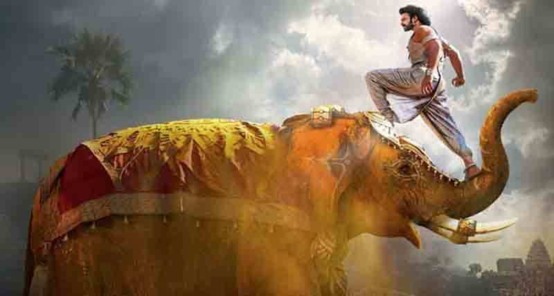 1 bahubali standing on trunk of elephant